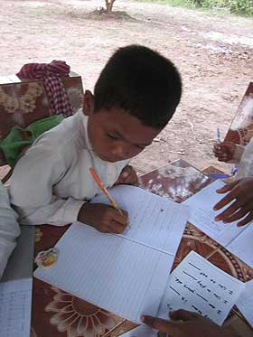 picture of young boy writing