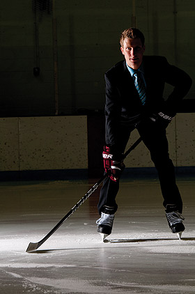Picture of hockey player in a suit