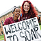 Students hold a Welcome to SOAR sign