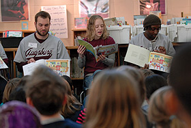 Picture of students reading a book